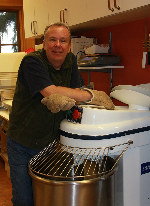 Baker Betz waits for a batch of diamond cookies to finish baking.