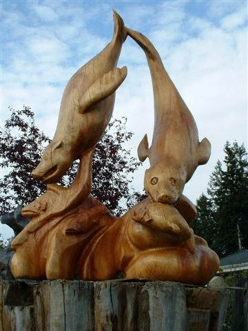 Pat McVay carves Northwest animals out of wood, among other pieces.