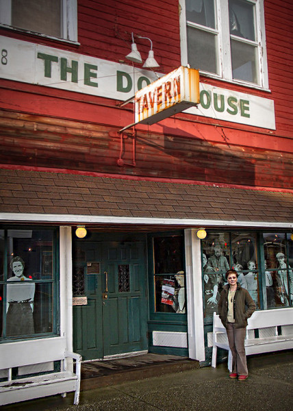In front of the historic Dog House Tavern, George mingles with replicas of town founders who populate the window.  Constructed by the Langley Main Street Association, these one-dimensional characters whisper their stories through the glass. (Photo by David Welton)