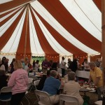 Some 125 book lovers gathered under Henry, the big tent behind Langley Middle School, to exchange books, vie for raffle prizes, disclose their #1 reads for the year and enjoy several soliloquies by Island Shakespeare Festival actors. The Festival continues on weekends through September 7.