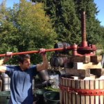 Apprentice Chris Hunter works the press at Ott & Murphy Winery on Whidbey Island.
