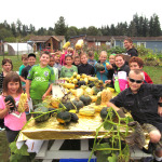 Squash displayed by proud growers and harvesters (photo by Cary Peterson)