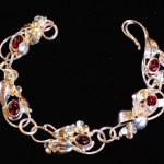 Barb Mundell of Bella Terra created this garnets, with gold and silver leaf-work bracelet.