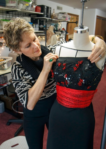Brenda working on dress for Seattle Symphony concert (photo by David Welton)