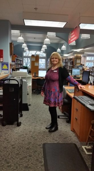 Vicky Welfare manages the Langley Library. (photo by Kate Poss)