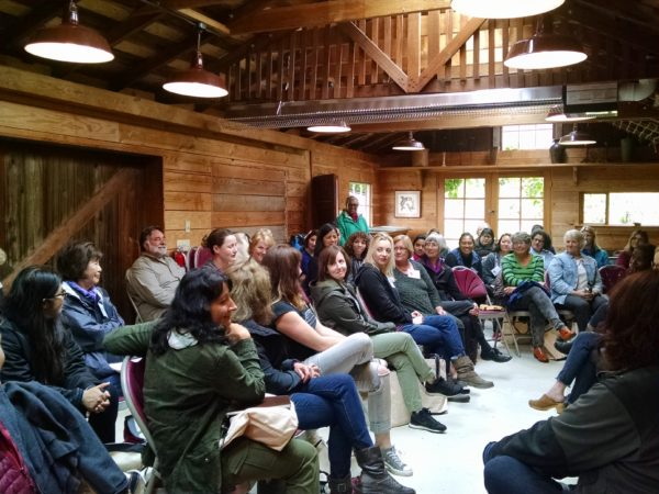 Vortext 2016 writing women, fortified by radical hospitality and each other, come together in the Long House on the Hedgebrook land for final words and dedication renewed. (photo by the author)