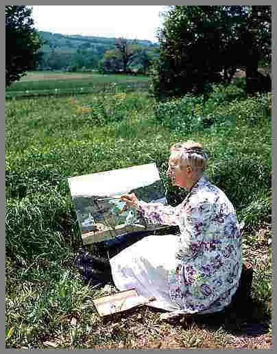 """Anna Mary Robertson, also known as """"Grandma Moses,"""" began painting in her 70s. Here she is plein aire painting in upstate New York, where she lived. (Photo courtesy of Hoosick Township Historical Society)"""