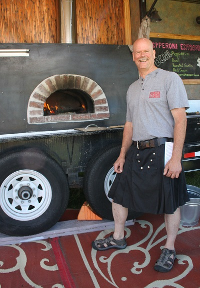 Reid Schwartz of Hot Rock Pizza stands by ready to bake. (Photos by Susan Wenzel)