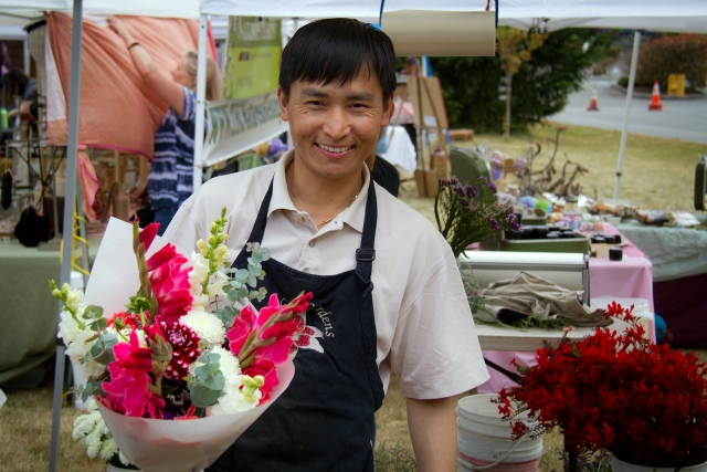 Chai Lor sells flowers at the market.