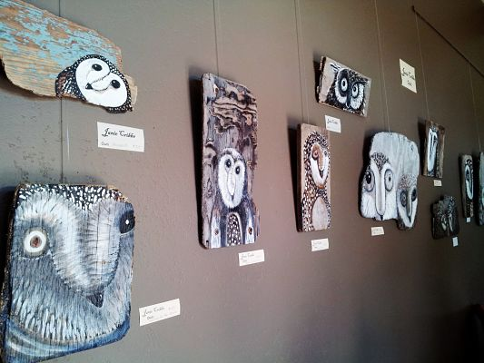 Owls on wood by Janie Cribbs at Blooms Winery.