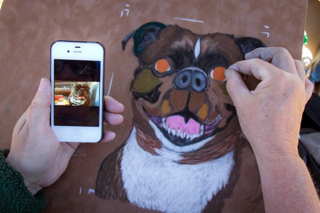 Susan Jensen makes character studies of clients' pets, sometimes with help from digital photos on her phone.