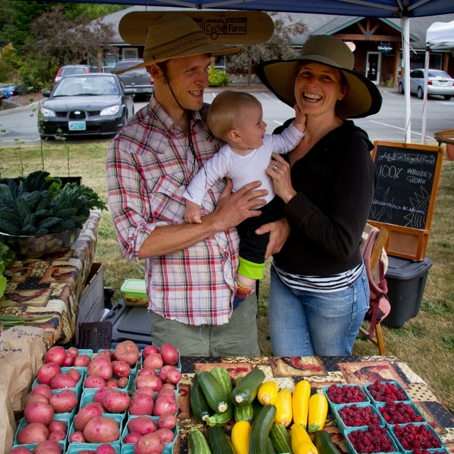 Full Cycle Farm, owners Eric and Britt Conn teach their son early about the ins and outs of selling produce  at Thursday Market in Clinton. (All photos by David Welton)