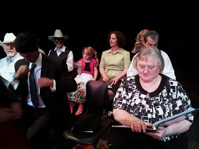 Actors wait onstage at the Postcards from Whidbey Island Radio-Theatre Variety Show. (Patricia Duff photo)