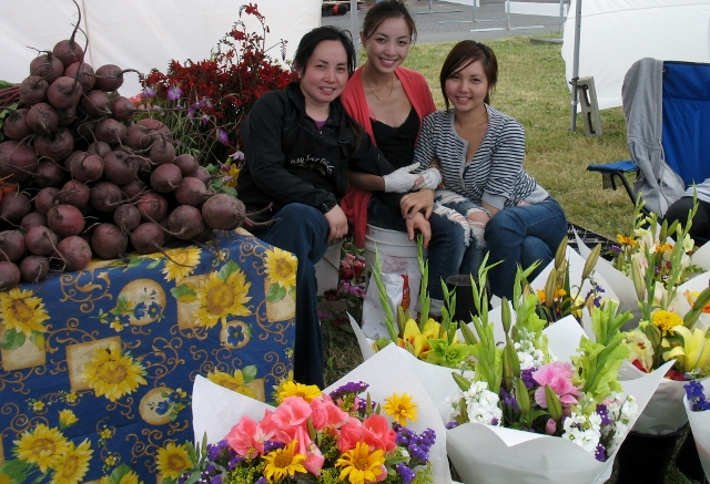 The flower sisters of Bao Lor Farm offer summer bouquets and seasonal vegetables at their popular Clinton Market stand. (Betty Freeman photo)