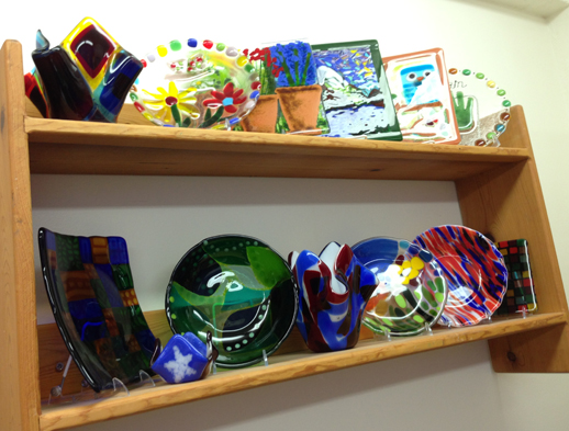 Fused glass adds to other colorful displays that adorn the Paint Escape shop.
