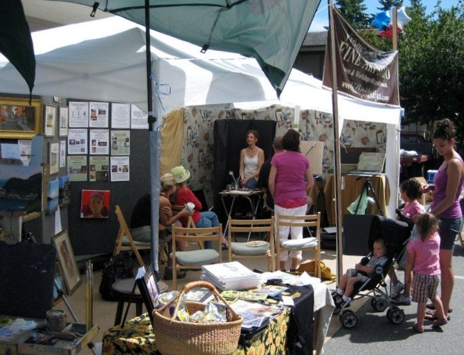 Art demonstrations are set up in parking lot of the U.S. Bank in Langley for Choochokam Arts 2012.