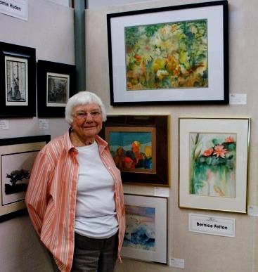 Bernice Felton stands in front of her work at last years' ASW Show and Sale. (Photo courtesy of ASW)