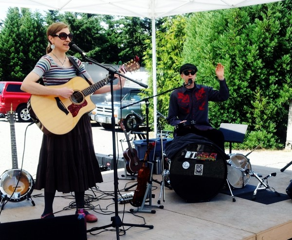 The Winterlings, Amanda Birdsall and Wolff Bowden, entertains the crowd at the food court during the festival.