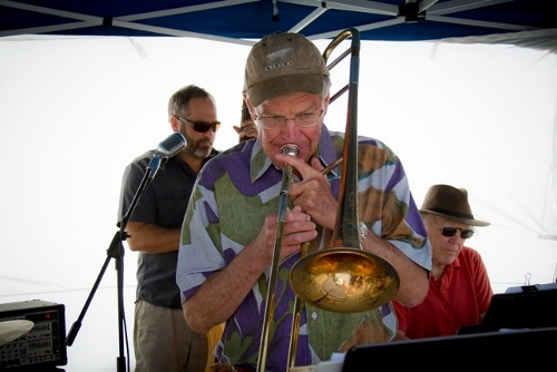John Barney adds more brassy flavor with his trombone.