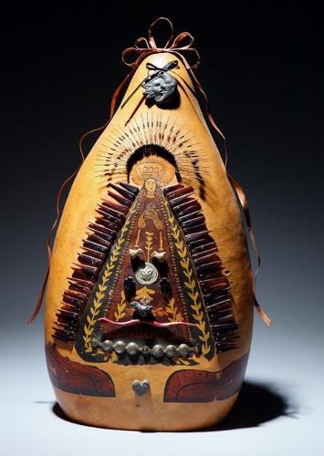 Deborah Eimers decorates gourds with mystic symbols in her Langley studio.