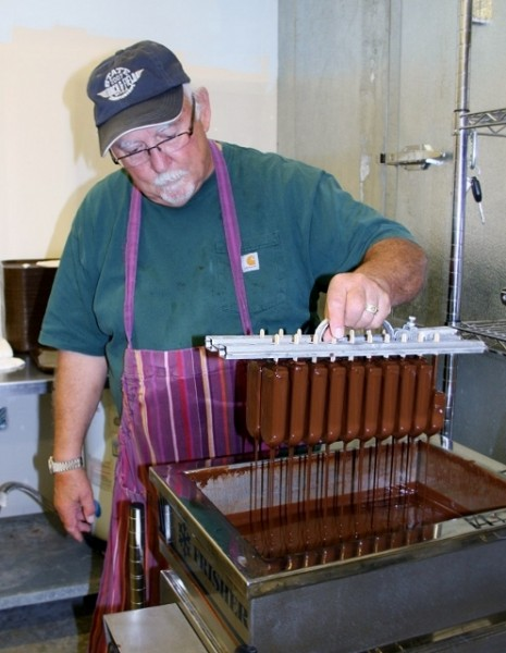 Ron Hecker does some dipping of ice cream bars at the Whidbey Island Ice Cream factory. (Susan Wenzel photos)