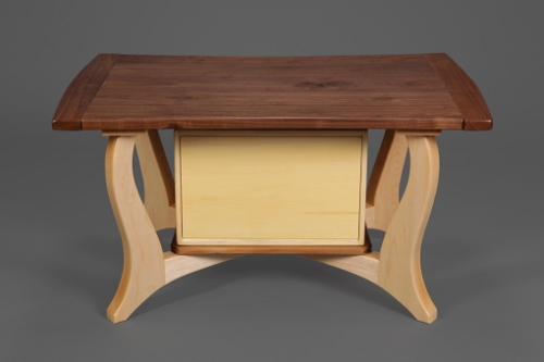 This walnut and maple occasional table is by artist John Shinneman.
