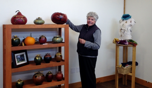 Susanne Newbold sets up her fine art gourd art at Bayview Cash Store for Handcrafted on Whidbey.