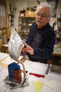 Dan explains the finish on a sculpture in process during a visit to his studio.