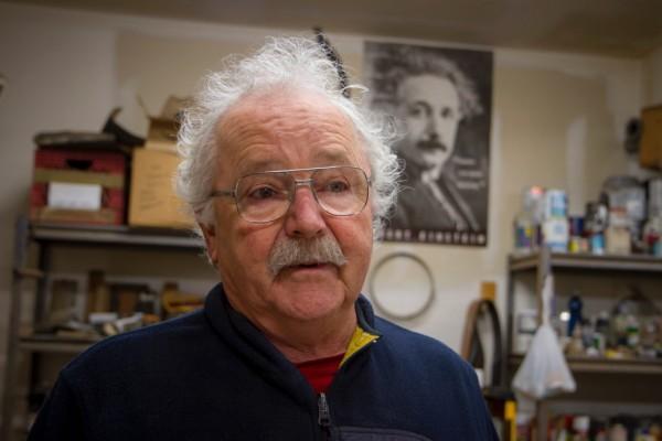 Dan discusses art as Einstein looks on.