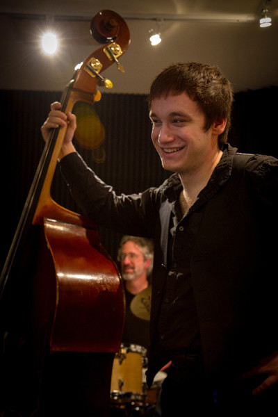 Ace bassist Jon Small smiles as his father, Scott, looks on in the background.  (Photo by David Welton)