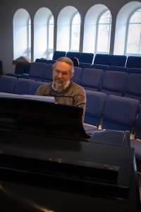 Karl practices music for Sunday service. (photo by David Welton)