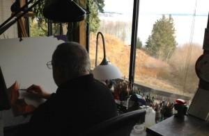 Ursillo working over his desk in his studio  (photo by Carolyn Tamler)