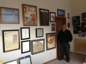 Ursillo in his studio next to samples of his artwork (photo by Carolyn Tamler)
