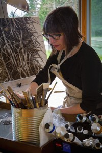 Evelyn Woods in her studio working on a new painting (photo credit David Welton)