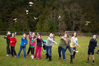 Member's of John Lavassar's class line up for a group launching of their lightweight balsa gliders.