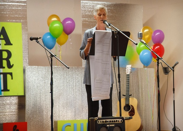 Marsha Morgan, MC, sings her thanks for everyone who made WLM and the magazine a possibility. (photo by Vicky Brown)