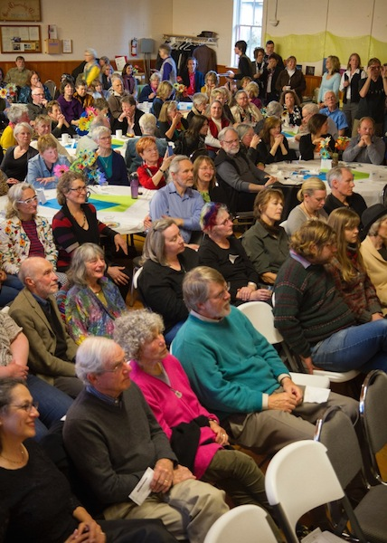 A sea of people listen as MC Marsha Morgan introduces musicians Gloria Ferry-Brennan and Sophia Duccini (photo by David Welton).