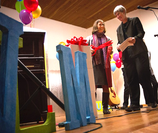 "Helen Price Johnson, Island County Commissioner, 1st District, cuts the ceremonial ribbon to ""release"" the 1st edition of the print edition of Whidbey Life Magazine. Sue Taves, publisher, says ""at last!"" (photo by David Welton)"