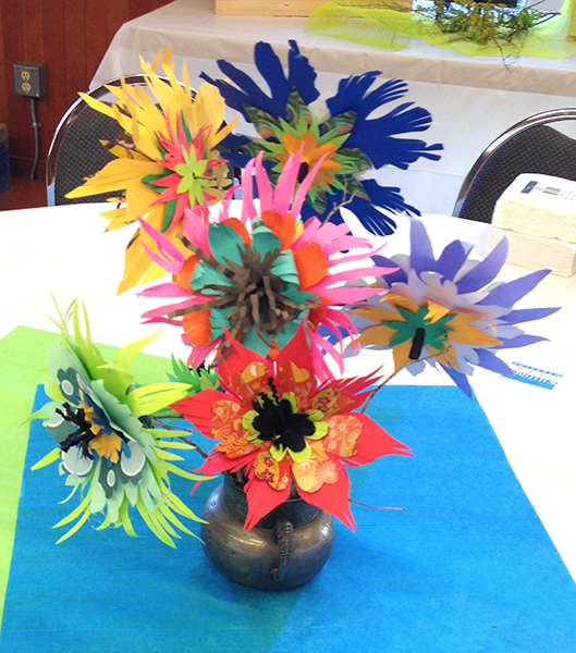 Peggy Moe's colorful, hand-crafted flower bouquets decorated all the tables and the stage. (photo by Vicky Brown)