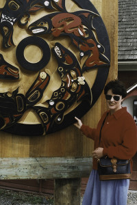 Sara Purdue stands by the Salmon Wheel in Coupeville in 1996 (photo courtesy of Sara Purdue)