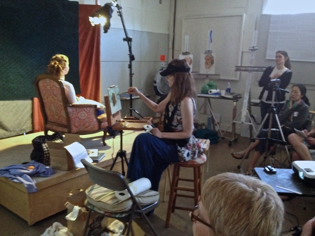 Students watch a painting demonstration at Whidbey Island Fine Arts Studio in Langley. / Photo courtesy of WIFAS