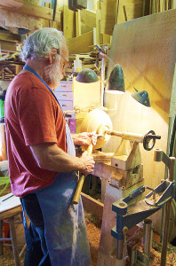 Jim Short turns a wooden bowl in his Coupeville workshop.  (photo by Martha McCartney)