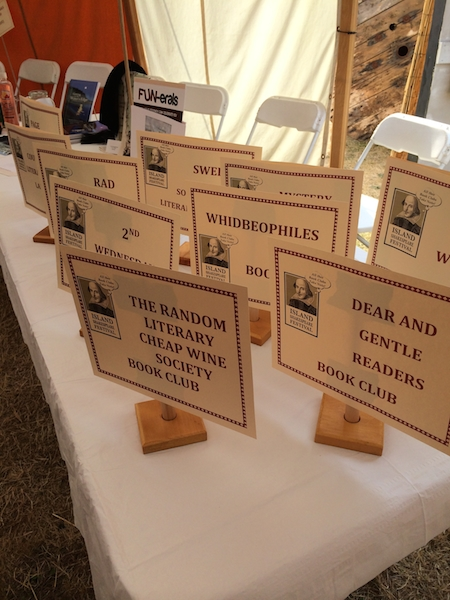 Table signs display some clever and amusing Book Club names. One of the most descriptive club names is ROMEO, which stands for Retired Old Men Eat Out. Photo courtesy of Donna Hood