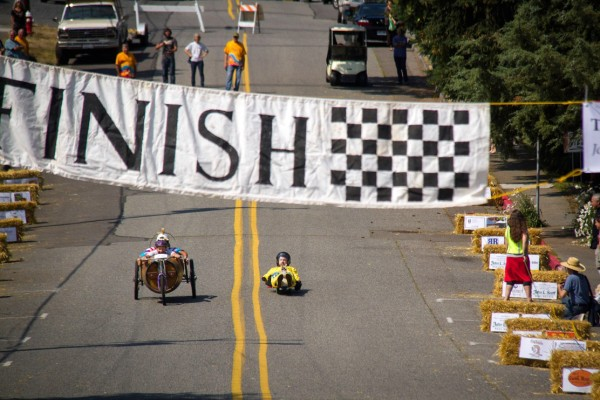 Elizabeth and Greg  Osenbach's Whidbey Island Winery grape barrel mobile edges out Donkey Kotay to win.