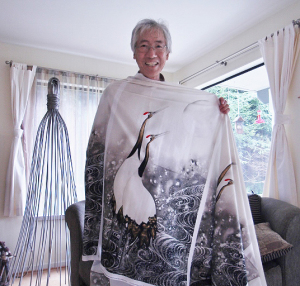 Keiichi Nishimura with a fabric panel using his art  (photo by Martha McCartney)
