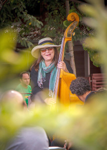Bassist Kristi O'Donnell enjoys a brief moment between songs. Photo by David Welton.