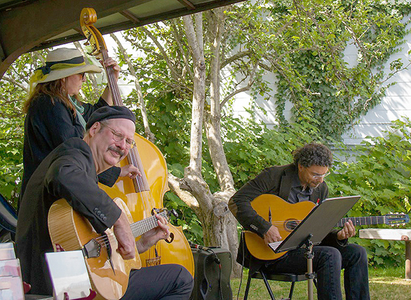 The Hot Club of Troy at a recent performance at Useless Bay Coffee. Keith Bowers in the foreground with Kristi O'Donnell on upright bass and Troy Chapman. Photo by David Welton.