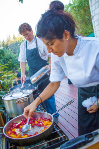 A skilled staff assists Nattress with careful handling of the fresh ingredients. (photo by David Welton)
