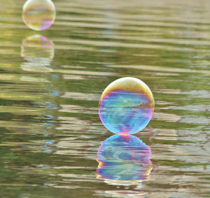 An opalescent sphere rests on the water's surface  (photo by Martha McCartney)