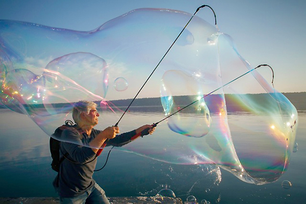Lindsay weaves his bubble wands  (photo by David Welton)